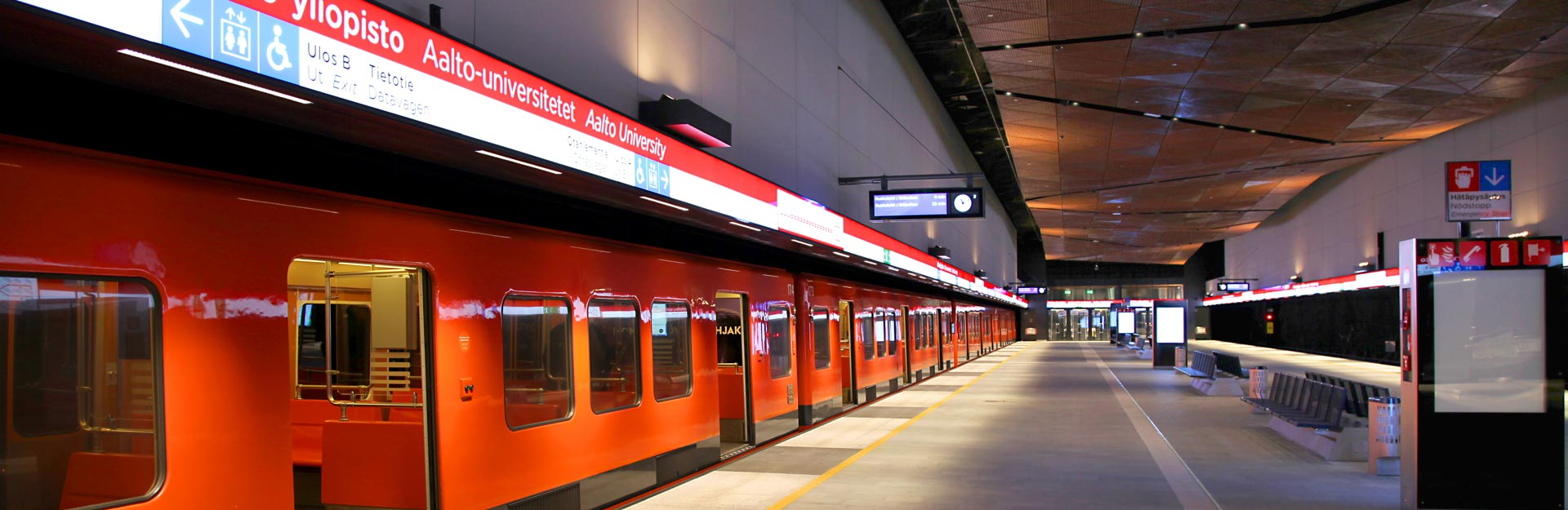 A metro standing at the Aalto University station.