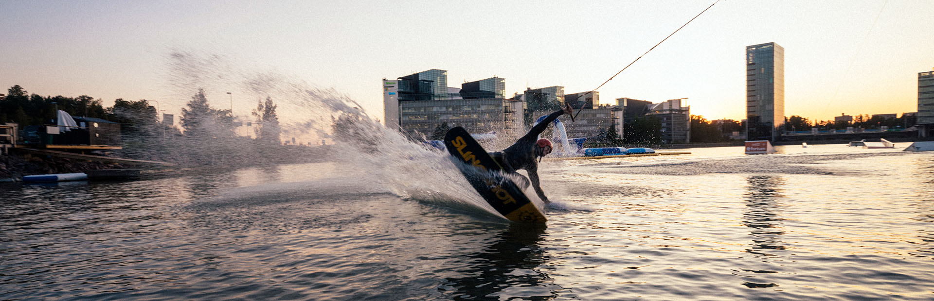 Wakeboarder in the shades of evening sun at the sea in Keilaniemi, Espoo.