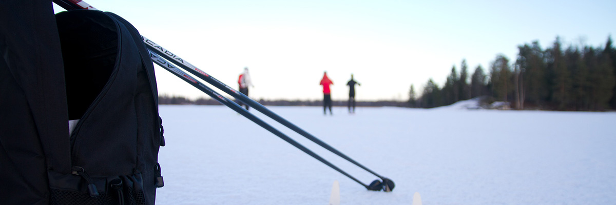 Cross country skiers skiing on the ice on a lake.